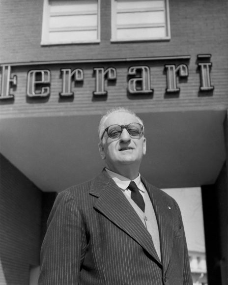(9)7. Enzo Ferrari at the entrance of the Ferrari Factory, 1957