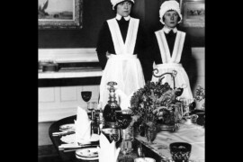 Parlourmaid and Under Parlourmaid ready to serve dinner 1939